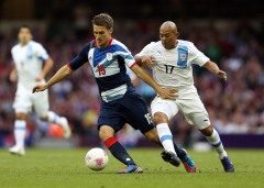 CARDIFF, WALES - AUGUST 01:  Aaron Ramsey of Great Britain holds off Egidio Arevalo of Uruguay  during the Men's Football first round Group A match between Great Britain and Uruguay on Day 5 of the London 2012 Olympic Games at Millennium Stadium on August 1, 2012 in Cardiff, Wales.  (Photo by Julian Finney/Getty Images)